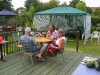 Alan, John and Audrey sitting on the patio overlooking the garden